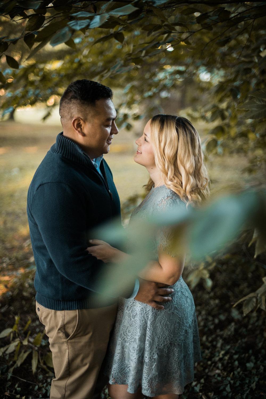 Couple seen through leafy tree