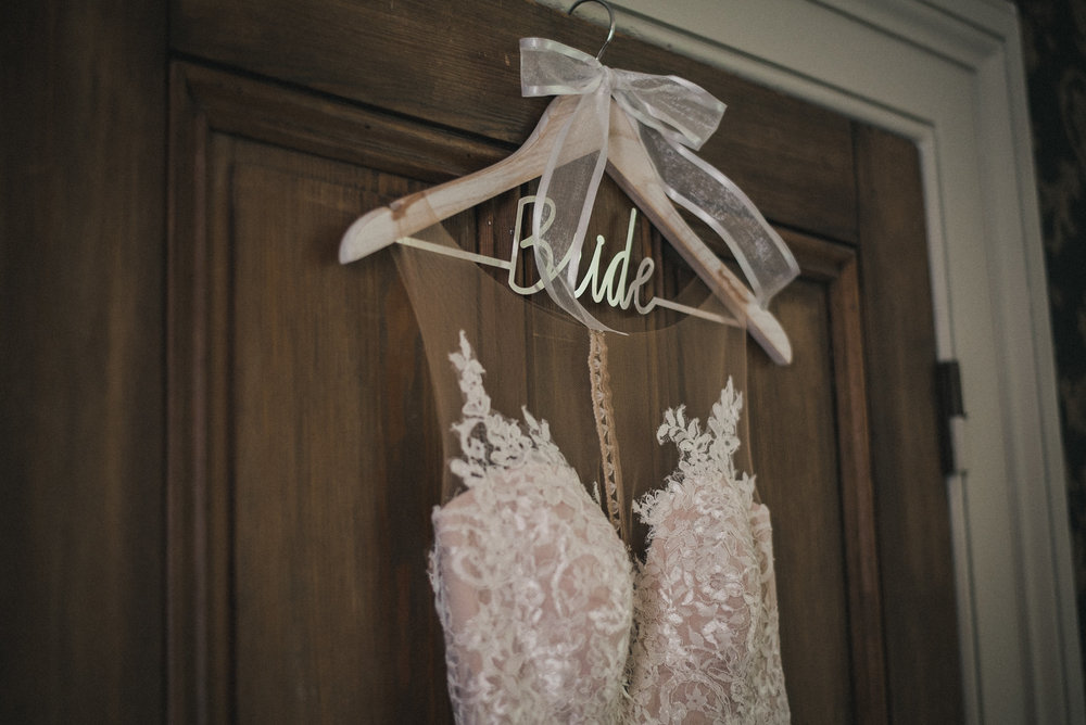 Bride's wedding dress on hanger