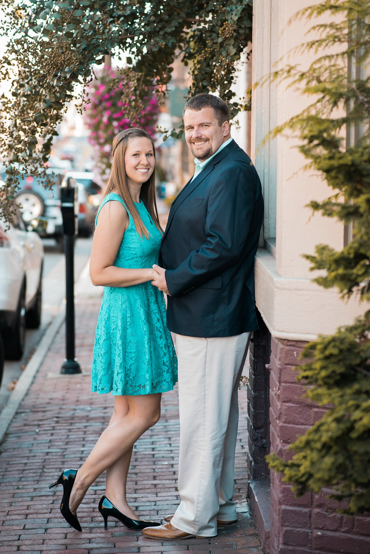 Couple posing on sidewalk