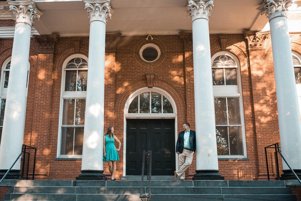 Couple standing between pillars