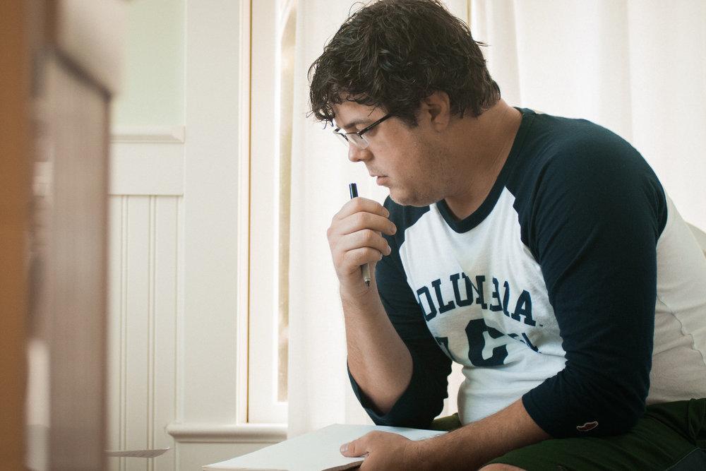 Man thinking about writing