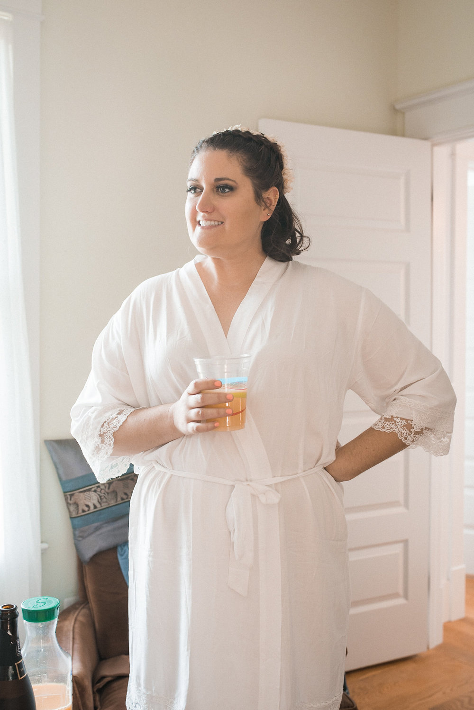 Bride standing in robe