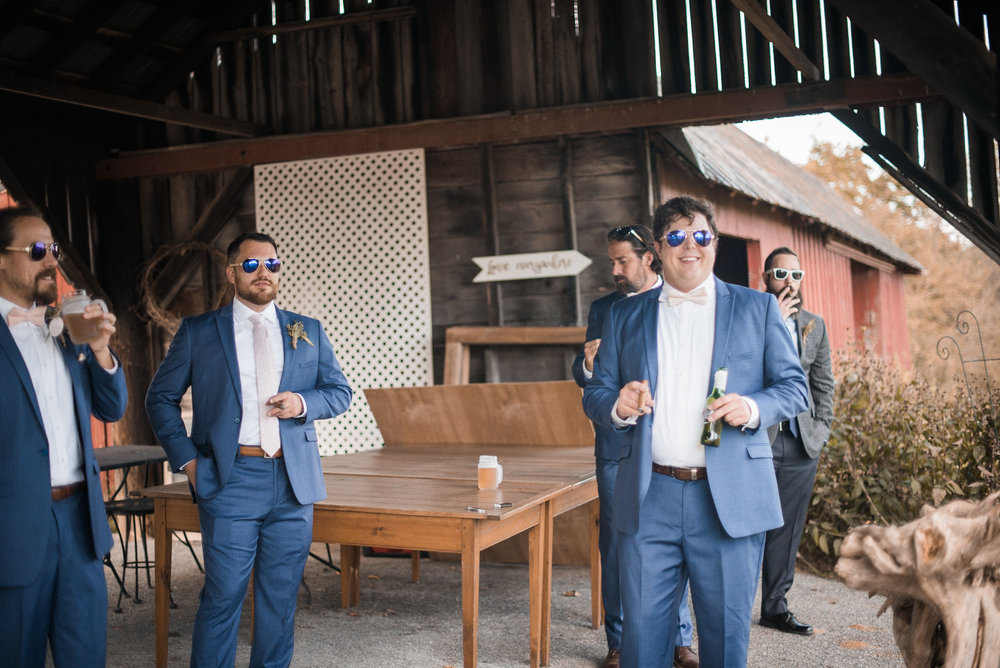 Groom and groomsmen smoking cigars