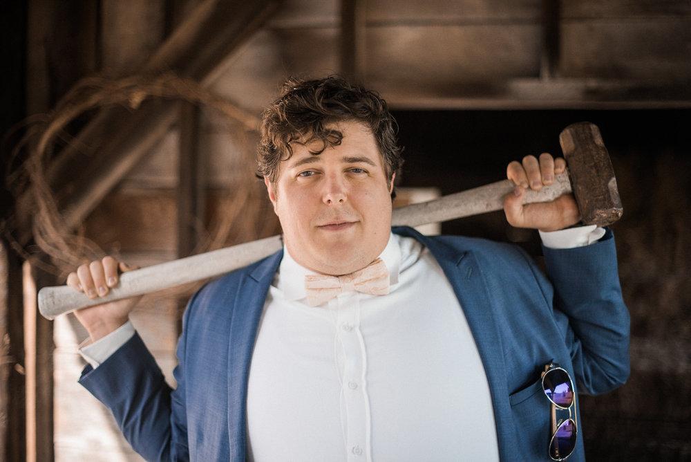Groom holding sledgehammer