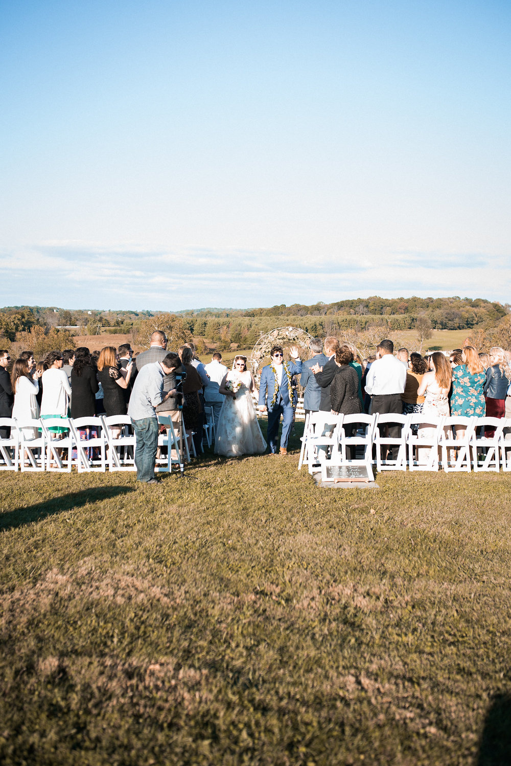 Guests at wedding ceremony as couple leaves