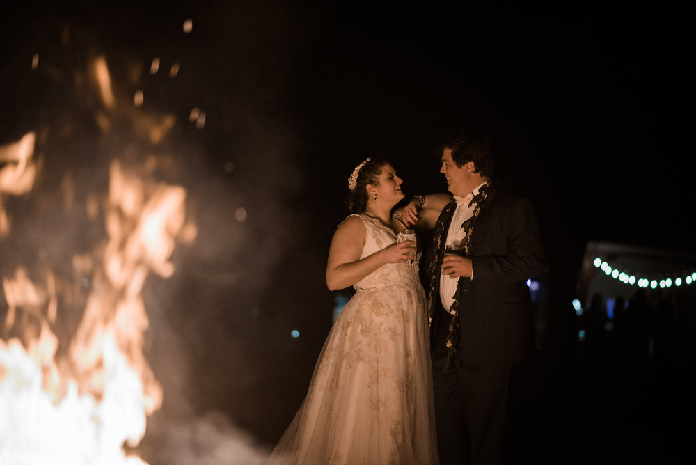 Bride and groom by bonfire