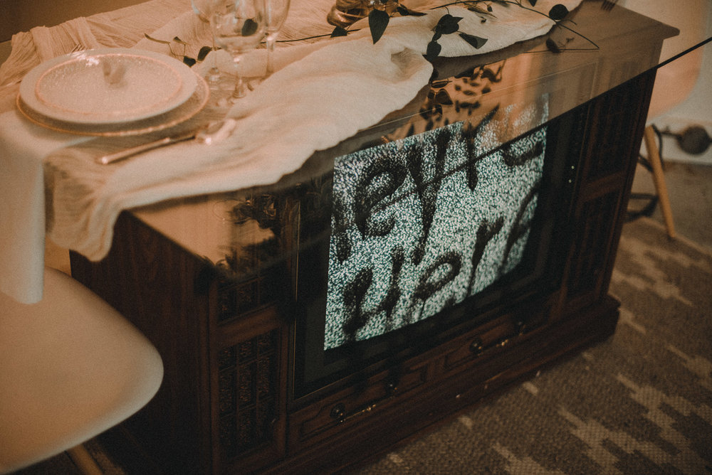 poltergeist television with plate settings