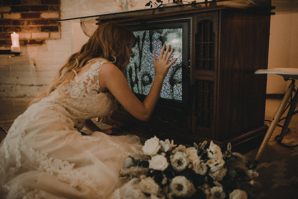 Bride leaning up against television