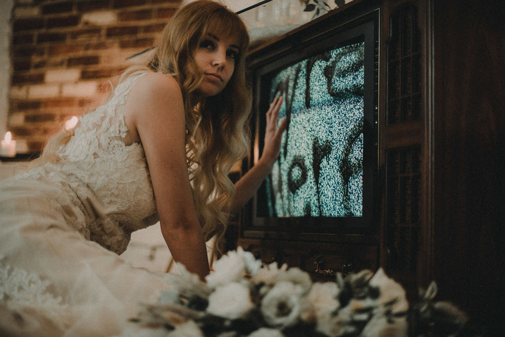Bride being called away from television screen