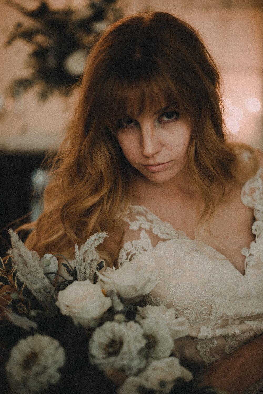 Bride moodily looking at camera