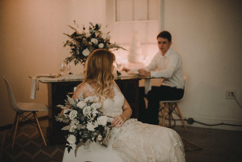 Bride looking back at groom