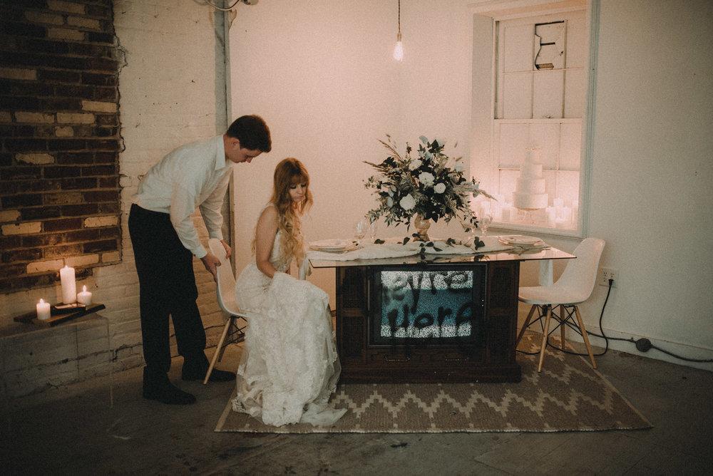 Groom pushing bride's seat in
