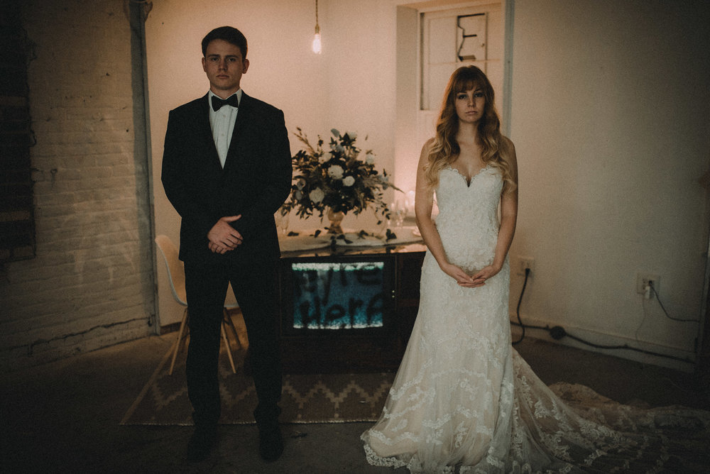 Bride and groom in front of haunted tv