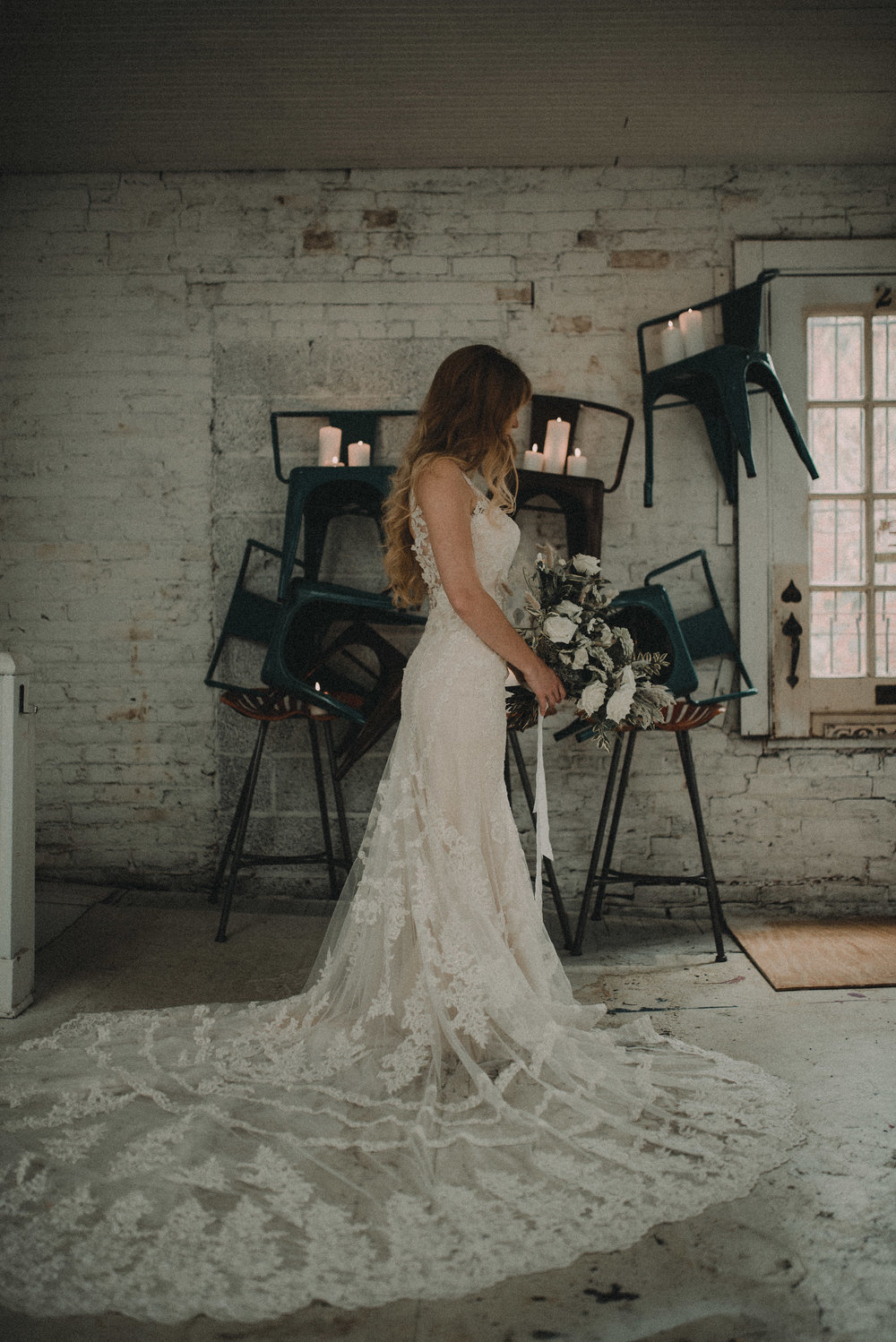 Bride in dress in front of levitating chairs