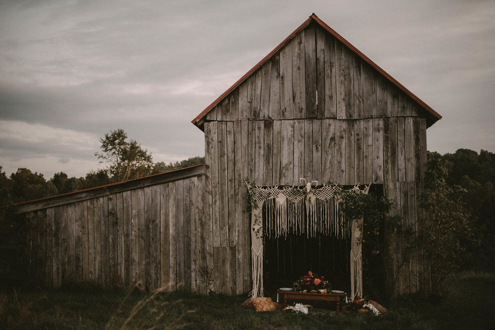 Old barn in field with wedding table