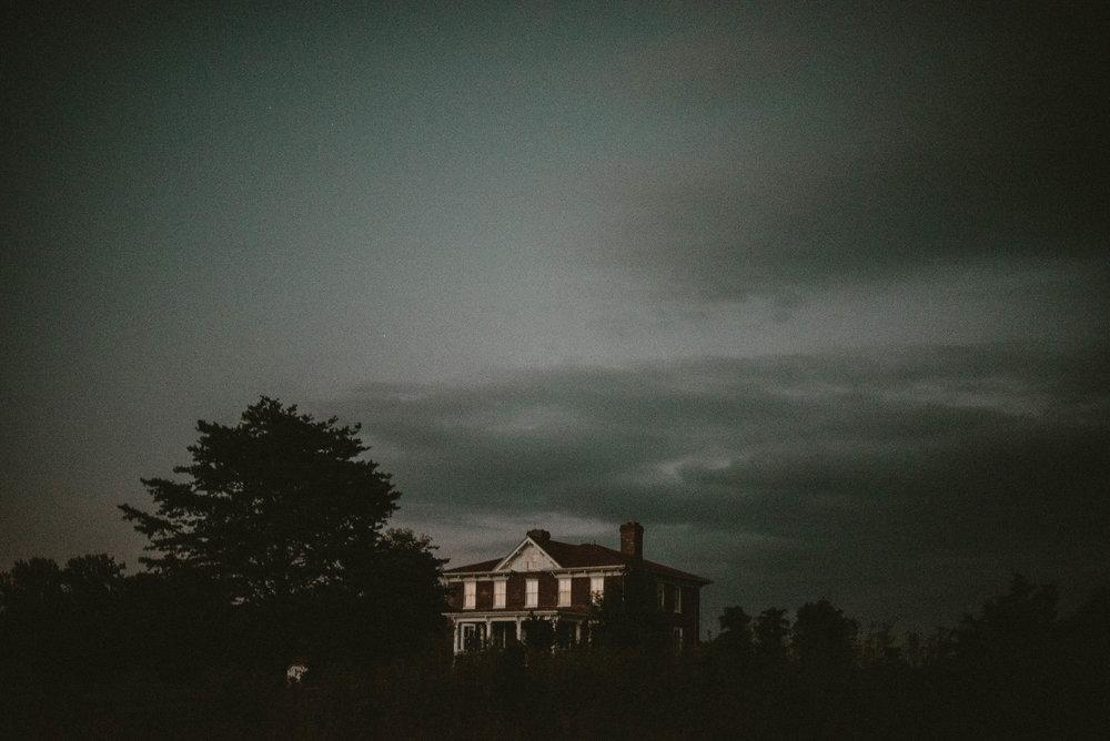 Spooky farmhouse at night