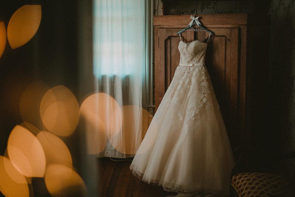 Wedding+dress+hanging+on+a+wardrobe.jpg