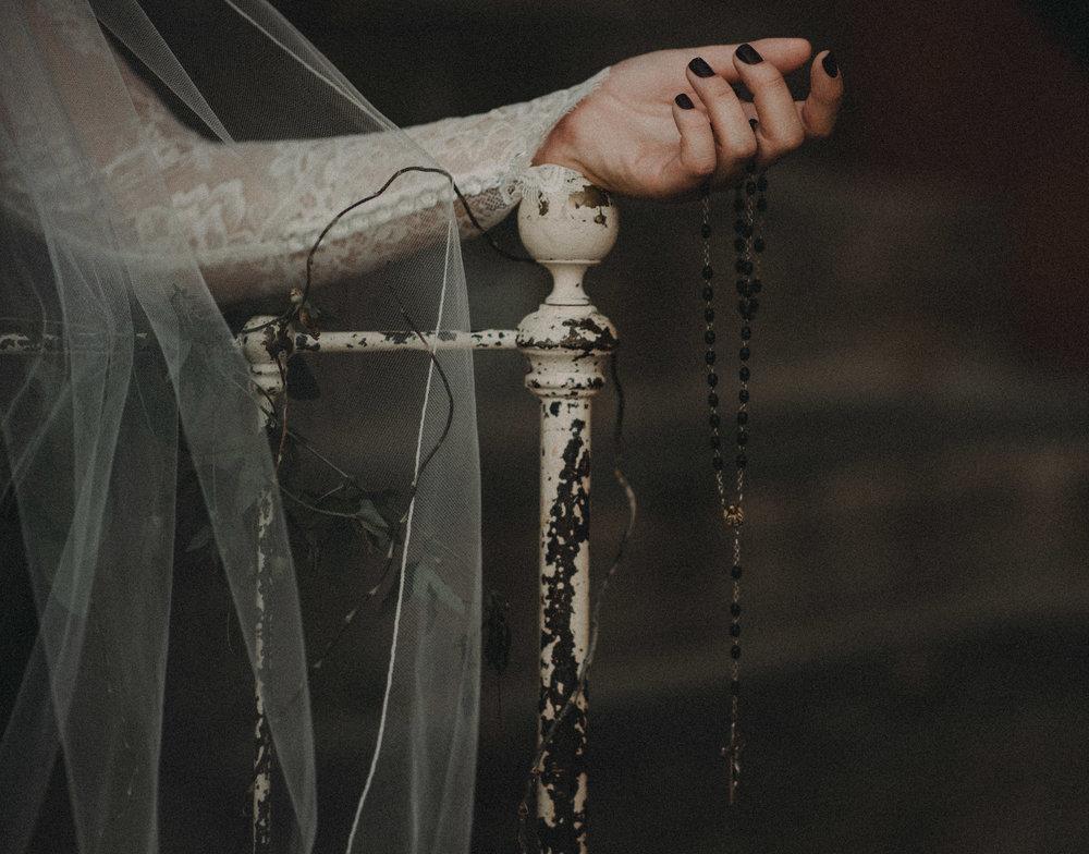 Bride's arm on vintage bed frame