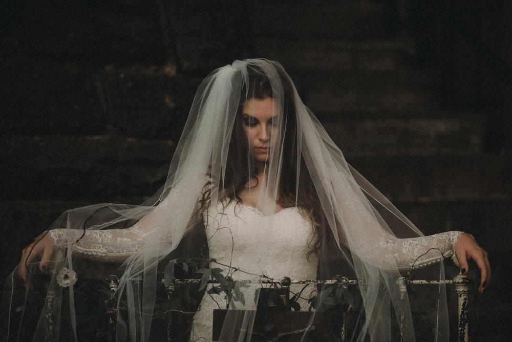 Bride posing on old bed frame