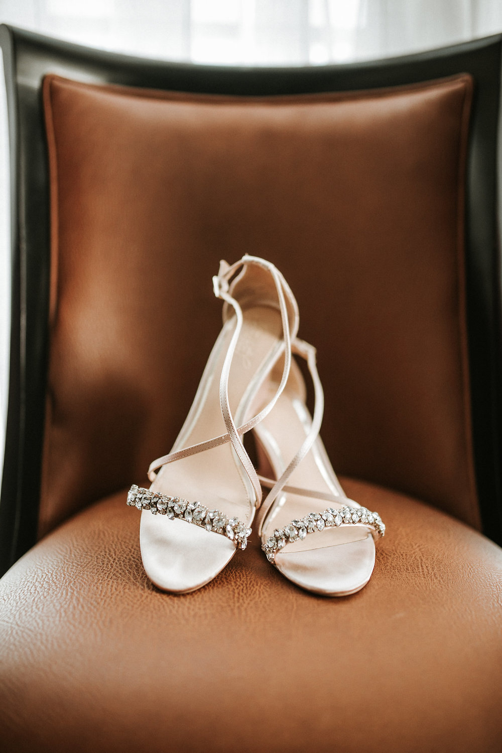 Wedding shoes on leather chair