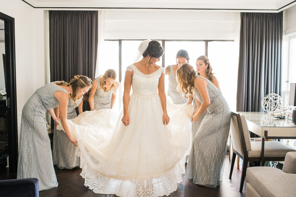 Bridesmaids fanning out dress