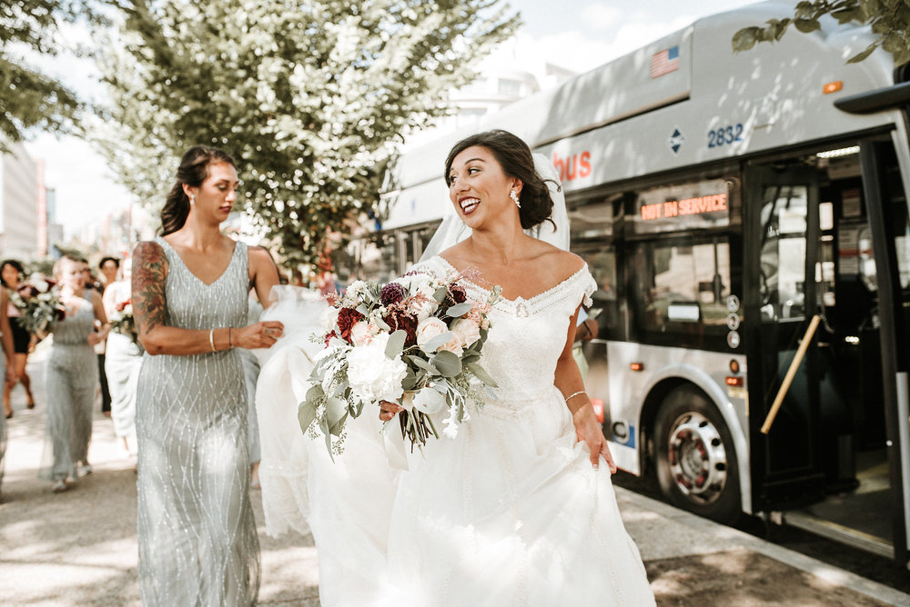 Bride and bridesmaids on sidewalk