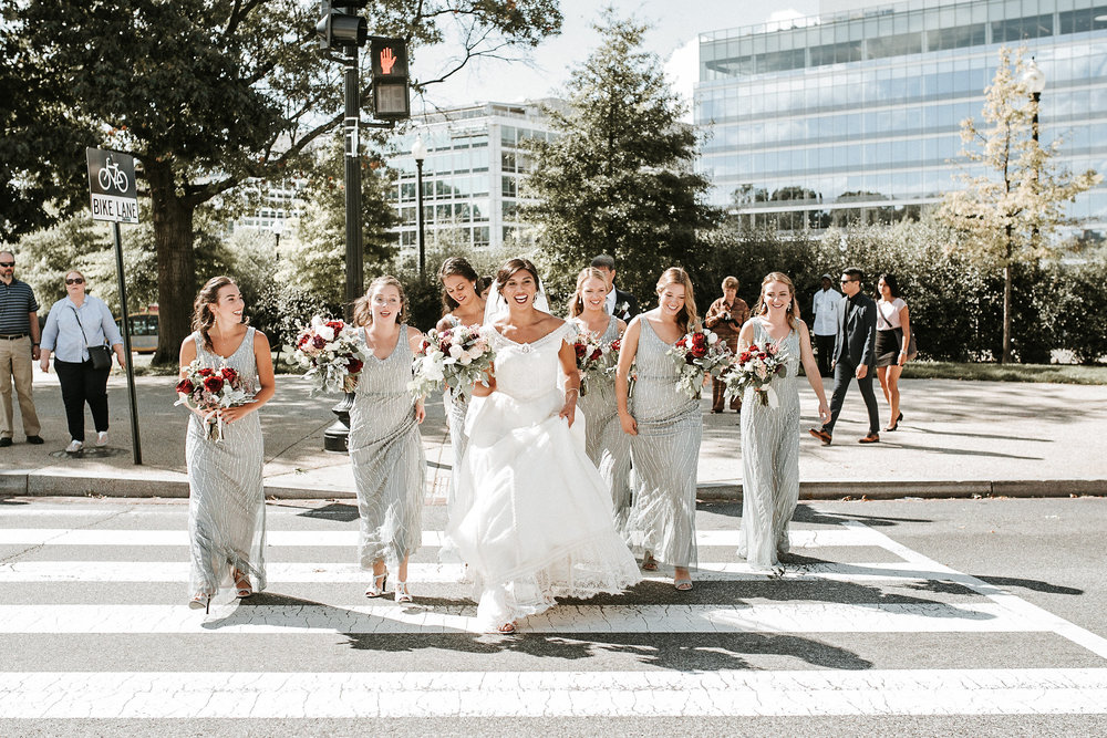 Bride and bridesmaids in cross walk