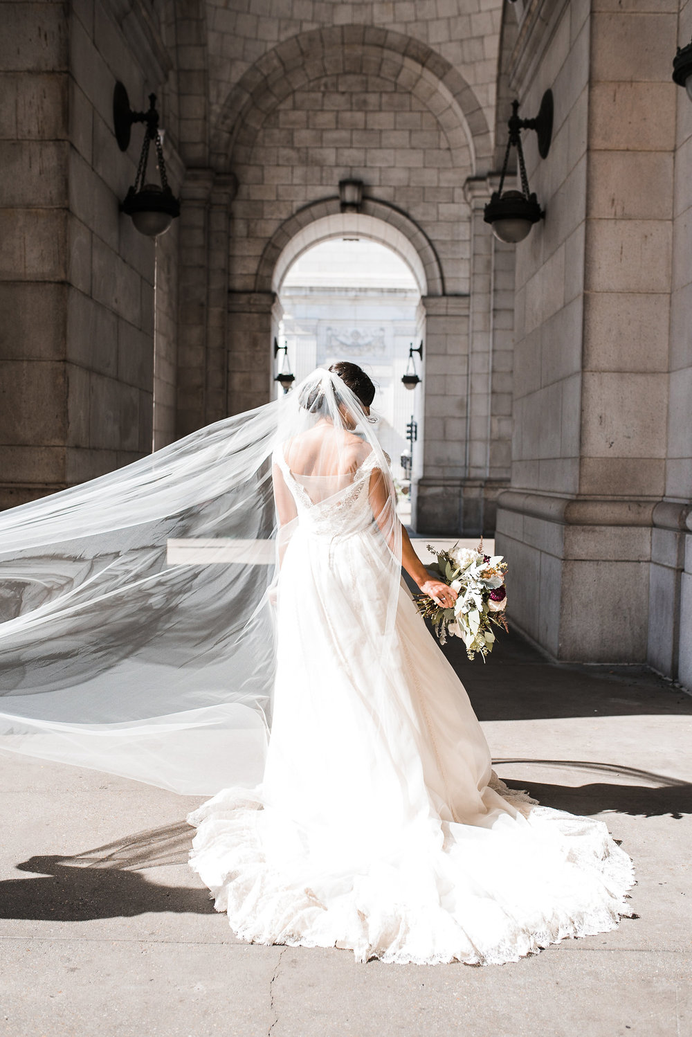 Bride's veil blowing in wind
