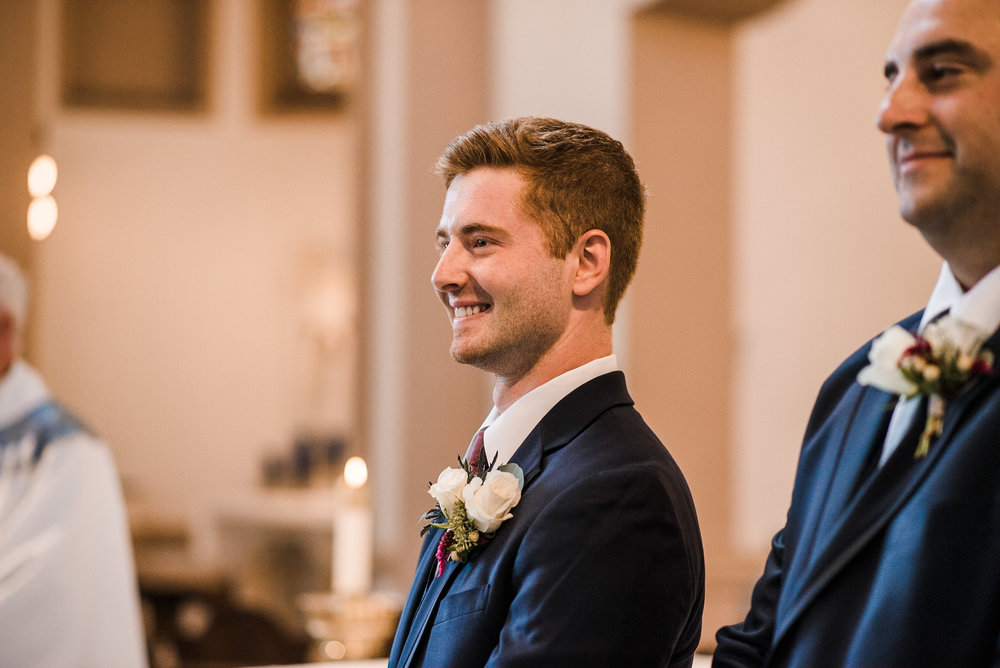 Groom standing at front of ceremony