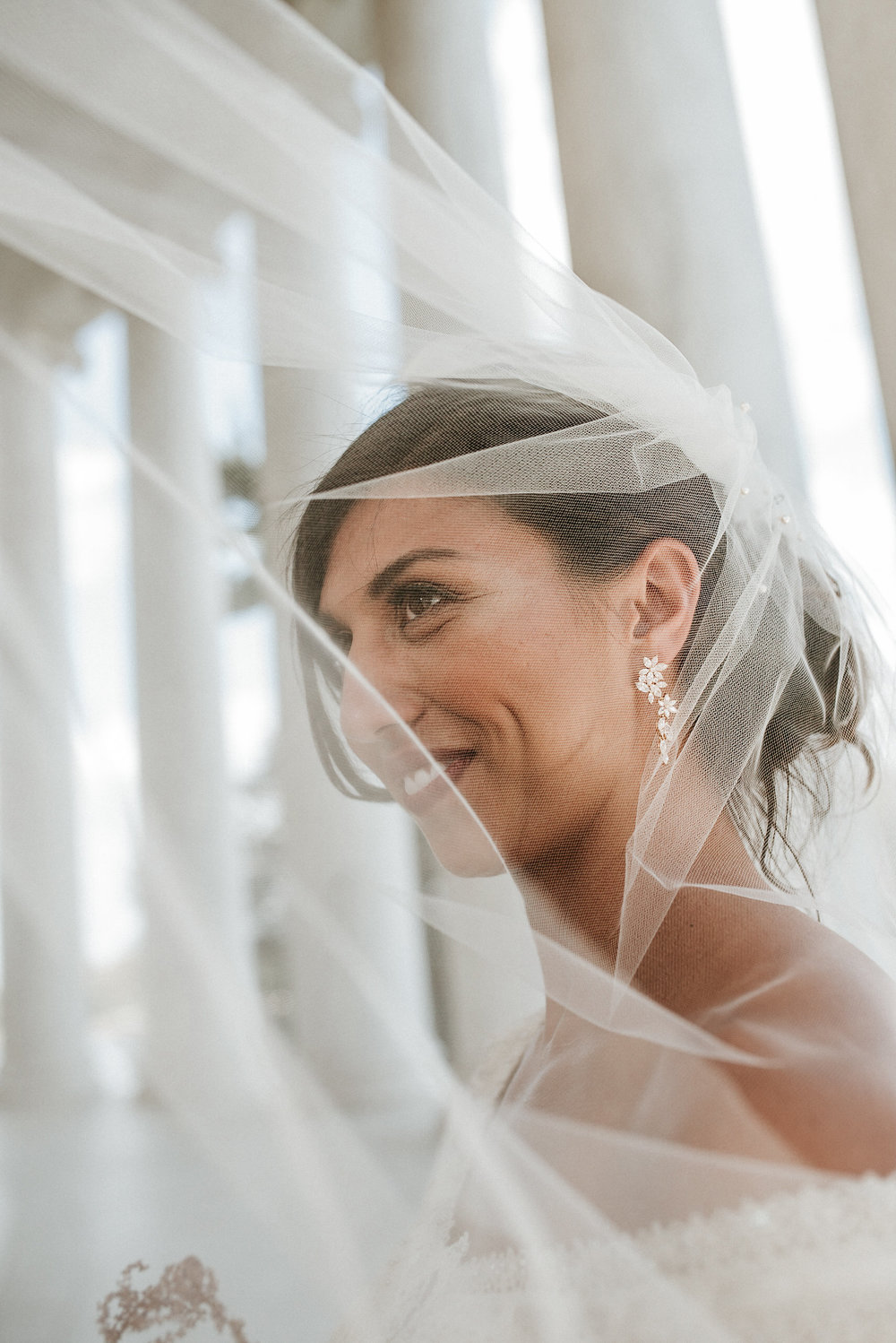 Bride under blowing veil