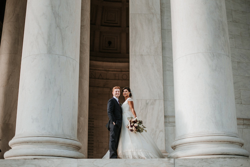Bride and groom between columns