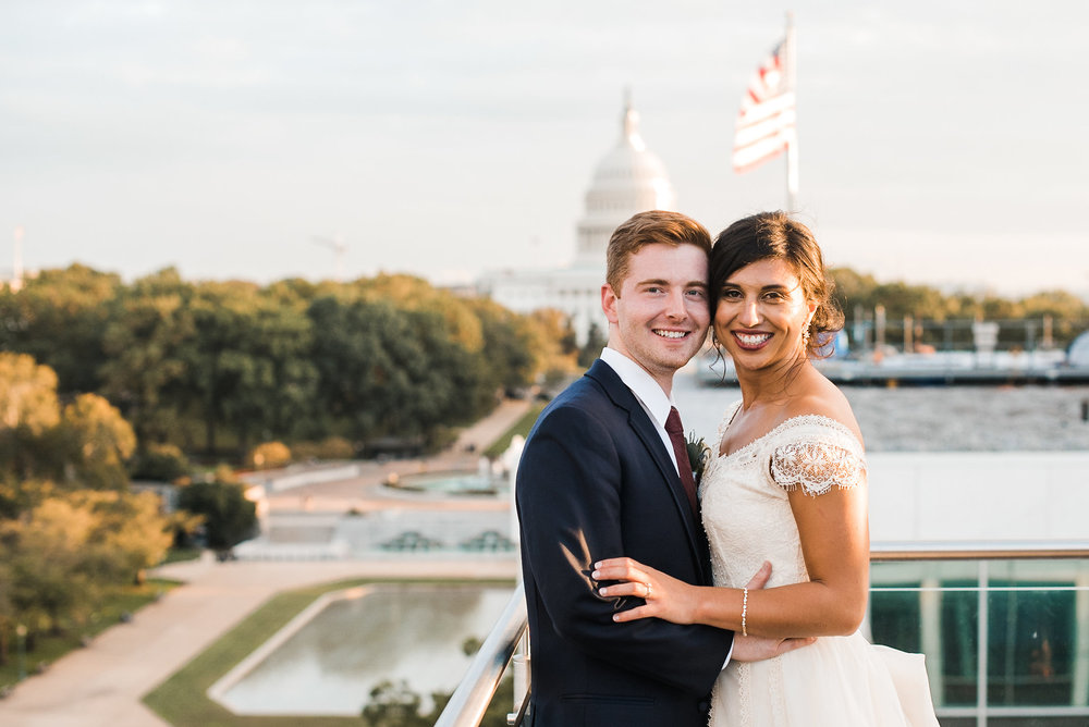 Bride and groom in front of capitol