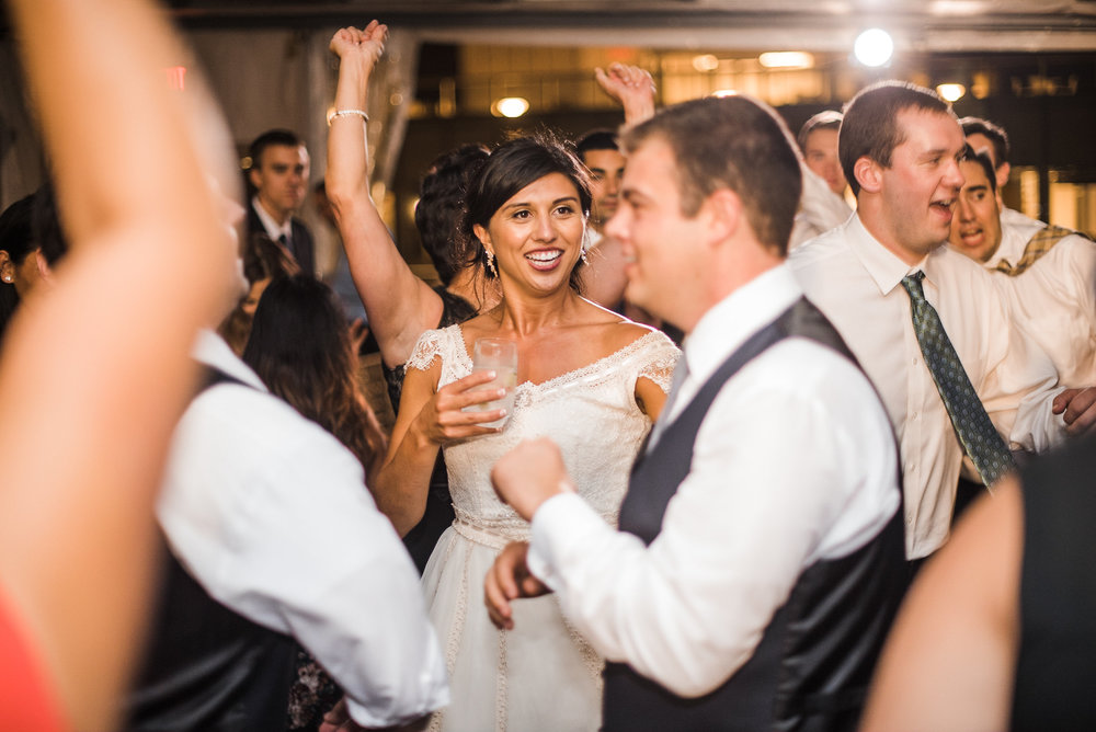 Bride dancing in crowd