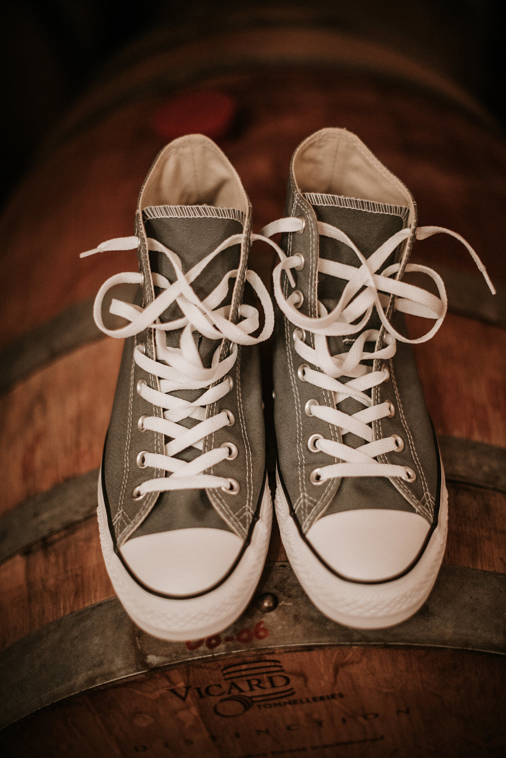 Converse on a wine barrel