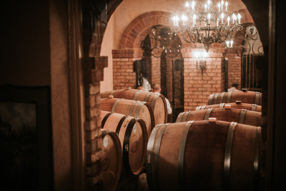 Groomsmen on wine cellar