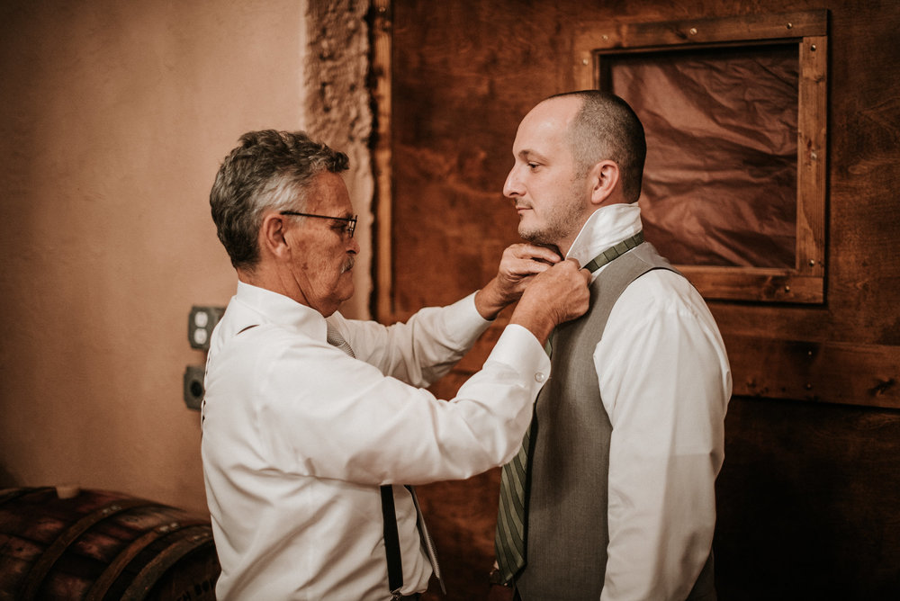 Groom's father tying tie