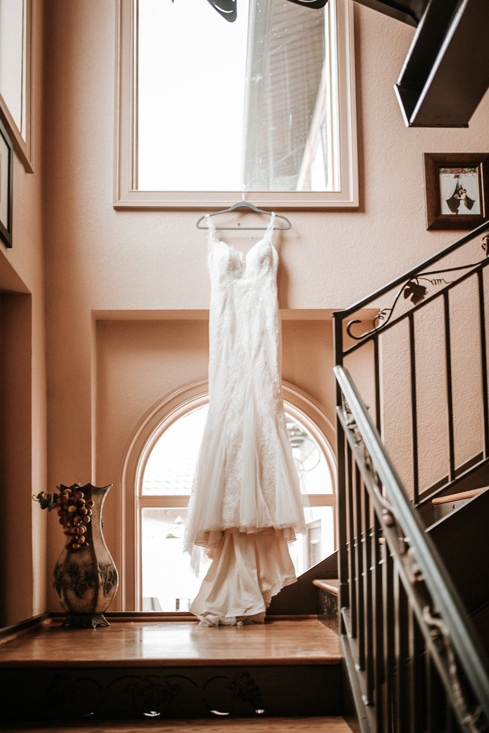 Bride's dress hanging on window