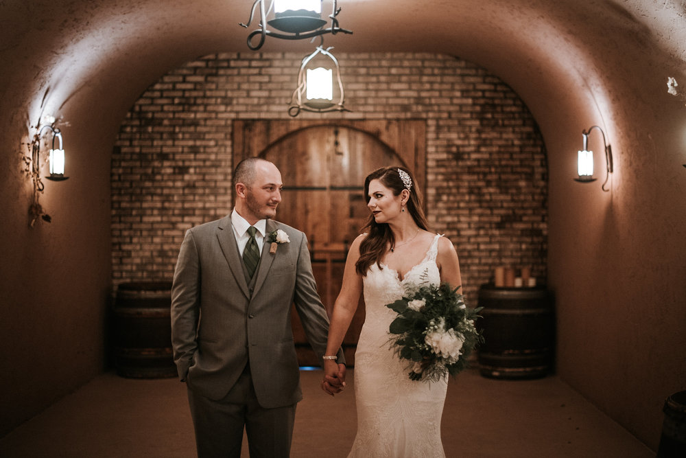 Bride and groom in wine cellar