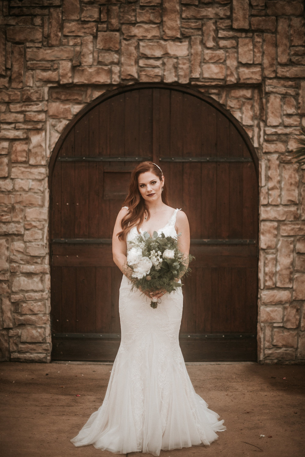 Glowing bride in front of door