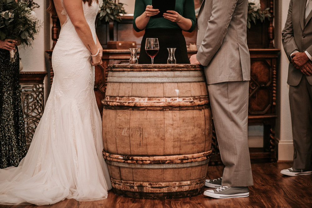 Barrel between bride and groom