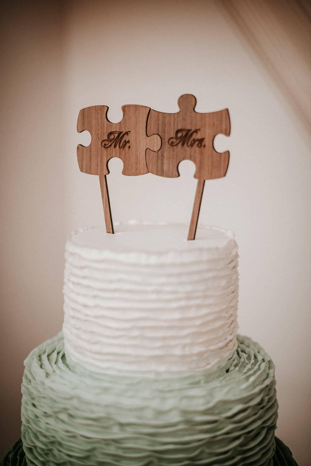 Wedding cake with puzzle piece topper