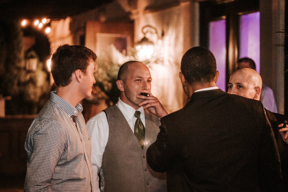 Groom smoking cigars