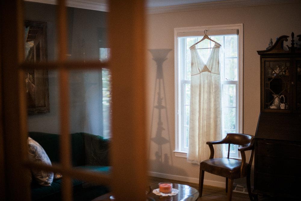 Dress hanging on windowsill