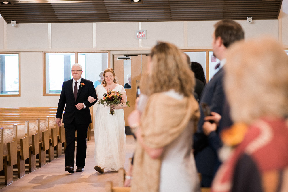 Bride walking up aisle