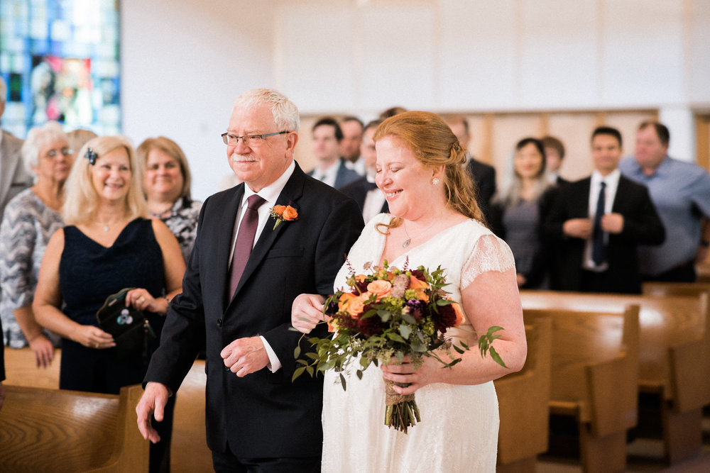 Father walking bride down aisle