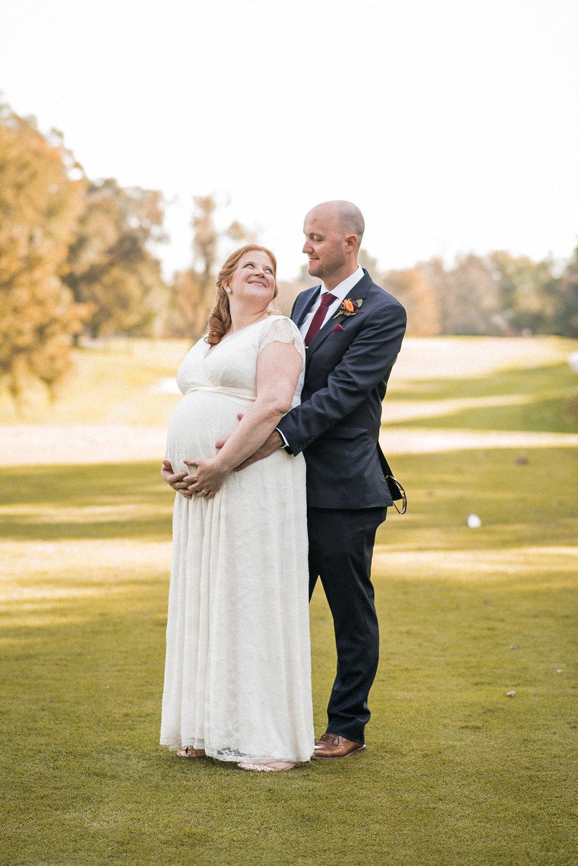 Bride looking over shoulder at groom
