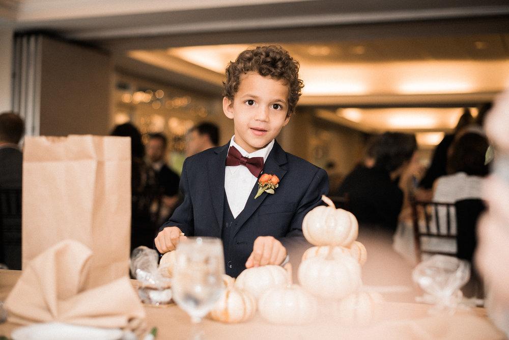 Child in tuxedo at wedding