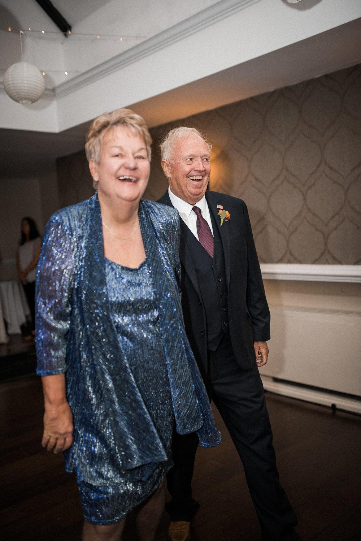 Family members dancing at wedding