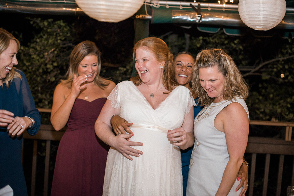 Bride laughing with girlfriends