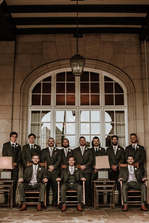 Groom and groomsmen posing at hotel